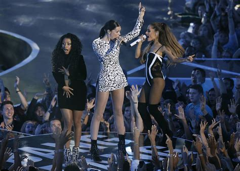 whats ariana grandes race ariana grande helps mtv video awards win ratings race