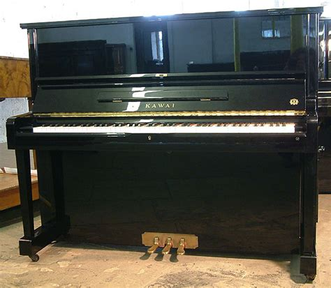 Bs20 Black kawai bs20 upright piano for sale with a black and
