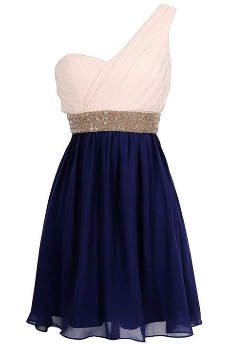 an adorable pink and navy blue dress with an attached