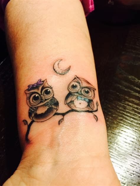 owl tattoo never lose hope picture of two owls tattoo on the wrist
