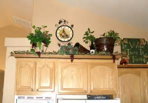 Decorating Over Kitchen Cabinets by Lady Goats Decorating Above Kitchen Cabinets