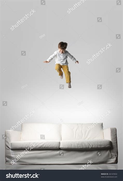 jumping on the sofa child jumping on a sofa stock photo 26147653 shutterstock