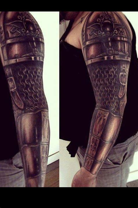 getting a medieval tattoo in fantastic armor on sleeve shoulder