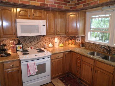 honey kitchen cabinets honey oak kitchen cabinets with light granite honey oak