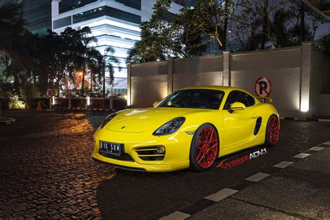 porsche cayman yellow yellow cayman s looking jaunty on matte red custom wheels