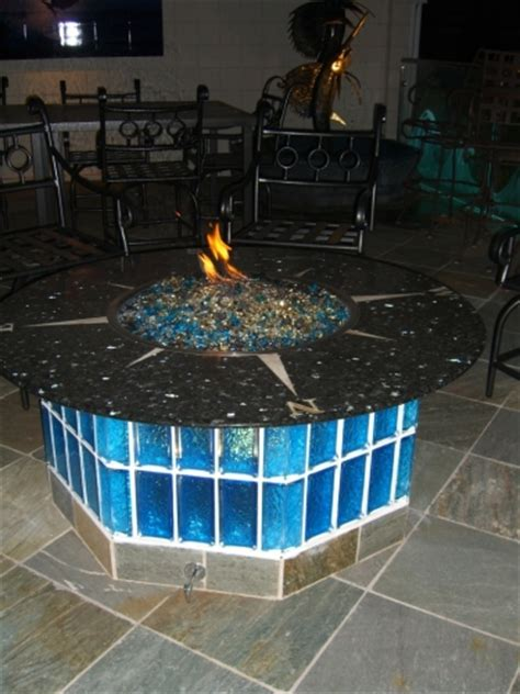 how does glass work in a pit pits tables fireplaces