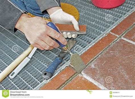 worker repairing and grouting patio royalty free stock