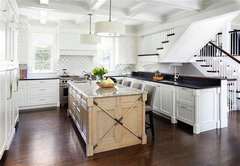 white enamel industrial light pendants  gray wash center island cottage kitchen