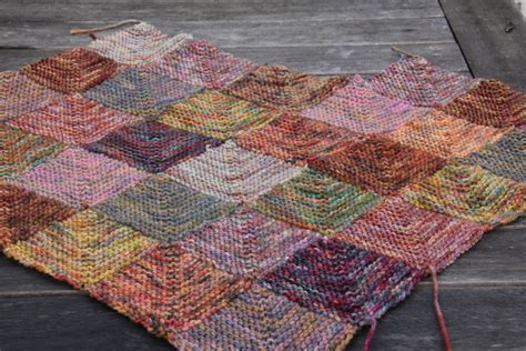 Knitted Patchwork Blanket Pattern - knit by numbers yarn sea green and sapphire