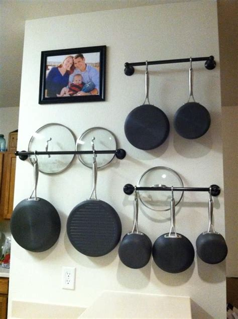 Small Square Kitchen Ideas by How To Choose The Right Rack For Hanging Pots And Pans