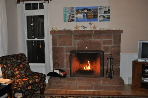 wood fireplace built with island sandstone in livingroom