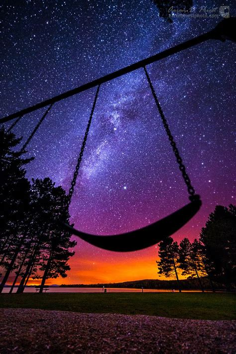 swing swing under the milky twilight milky way over lily bay state park on moosehead lake