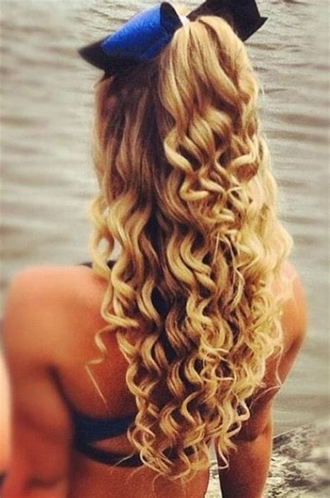 curly hairstyles for long hair tied up half up hair hair that has been tied up in a high half
