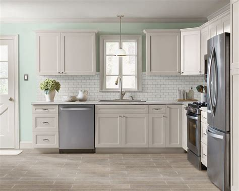 painting wood cabinets grey kitchen facelift refacing old cabinets subway tile