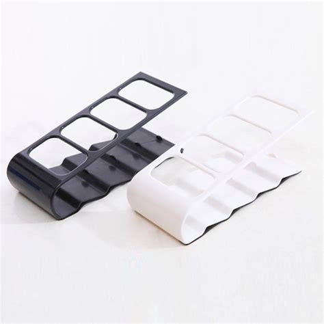 remote stand holder rack rak remot black jakartanotebook