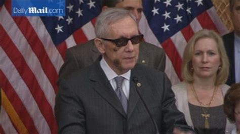 harry reid hides bruised face behind sunglasses following