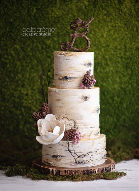 latest wedding cakes by de la cr 232 me creative studio tree wedding cakes sugar flowers and pinecone