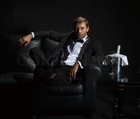 how to be sexier for your man in bed sexy man in tuxedo waiting for his date stock photo colourbox