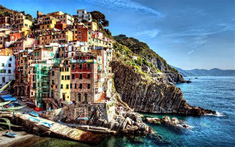 colorful hill cinque terre italy sea city dock boat building
