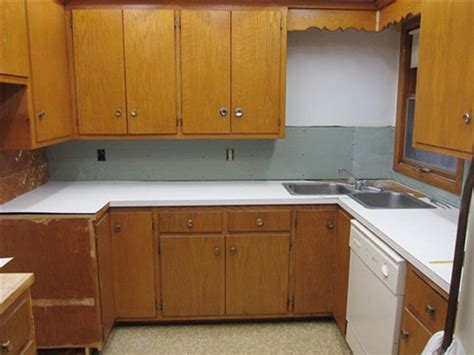 old wooden kitchen cabinets 5 ideas to repaint rebecca s faded wood kitchen cabinets