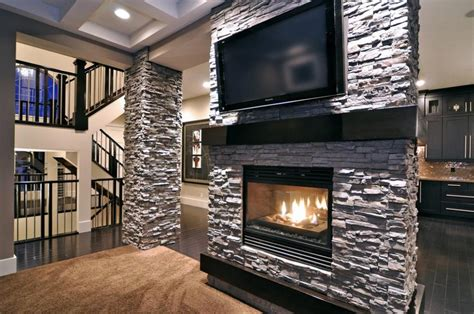 stacked stone accent wall with flat screen tv and