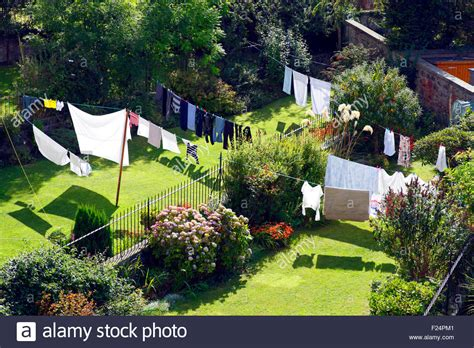 Line Gardens by Washing Line Clothes Drying In Suburban Back Gardens Stock