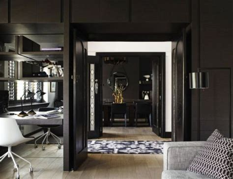 dark interior impressive black interior design with gold and orange accents digsdigs