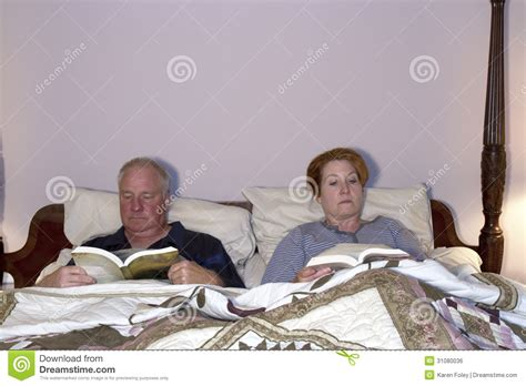 reading in bed couple reading in bed royalty free stock image image