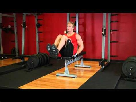 bench leg pull in seated flat bench leg pull in exercise guide and video2