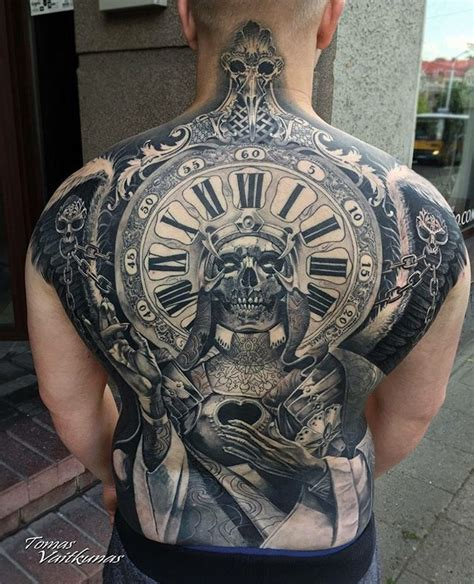 full back piece with skull and clock best tattoo design