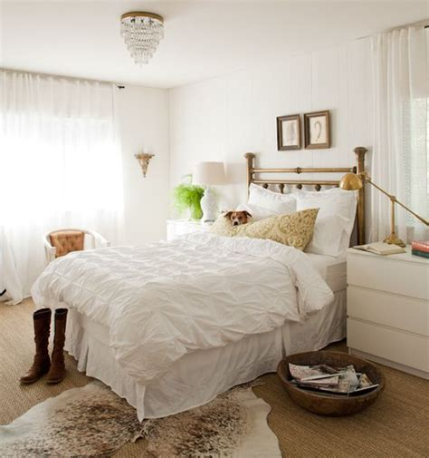bedroom with white carpet cowhide rugs and a few ways of using them in your interior