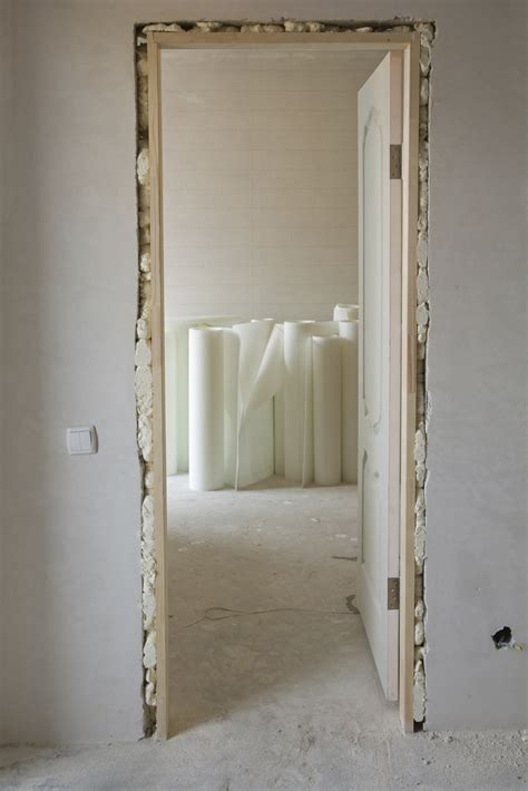 how to install a door in a wall how to install a door in an interior wall pro construction guide