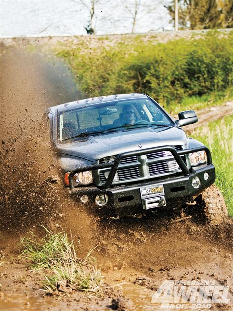 mudding trucks 1105 500 hp dodge ram mud truck front shot through mud