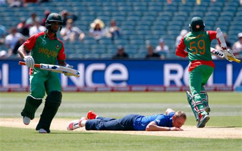 Syria Laser Bunga s bowler stuart broad c falls on the pitch after