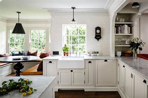 kitchen remodel turned breakfast nook lighting off center kitchen bay window nook banquette transitional kitchen