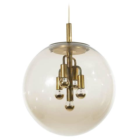 Glass Globe Pendant Lights Large Limburg Pendant Light Brass And Glass Globe 1960s At 1stdibs