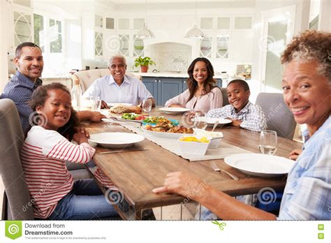 table family multi generation black family at kitchen table for a meal