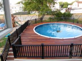 Building A Deck On A Sloped Backyard Above Ground Pool With Deck And Railings Traditional