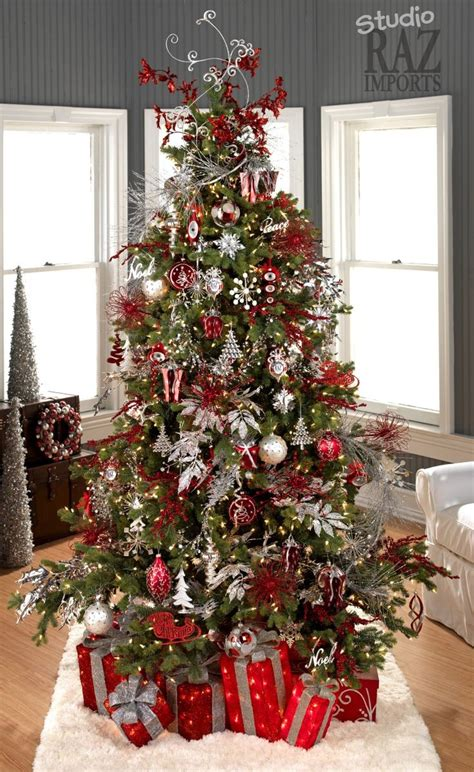 white christmas tree with red and silver decorations