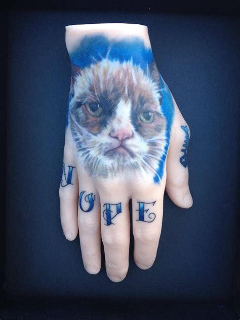 tattoo cat on hand beautiful cheshire cat tattoo on left hand