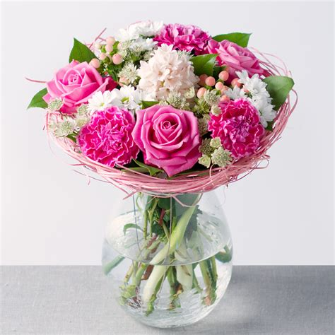 mixed spring flower arrangement in vase achica pink lemonade flowers by post bunches co uk