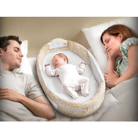 baby sleeping in bed with parents baby delight snuggle nest surround pinterest reunions