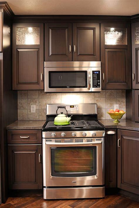 brown cabinet kitchen mullet cabinet brown condominium kitchen