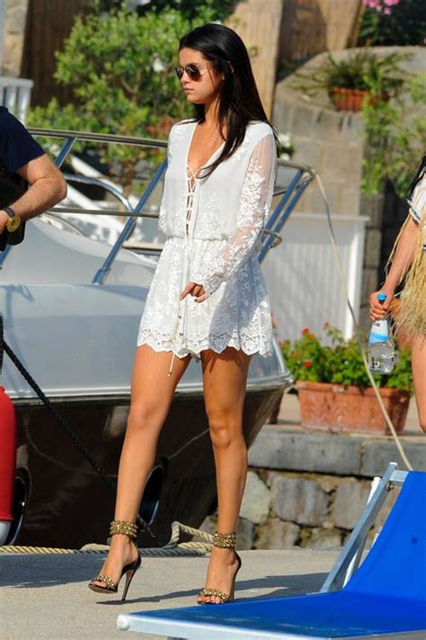 Selena Gomez summer street style with white dress and strap sandals.   Personajes   Pinterest