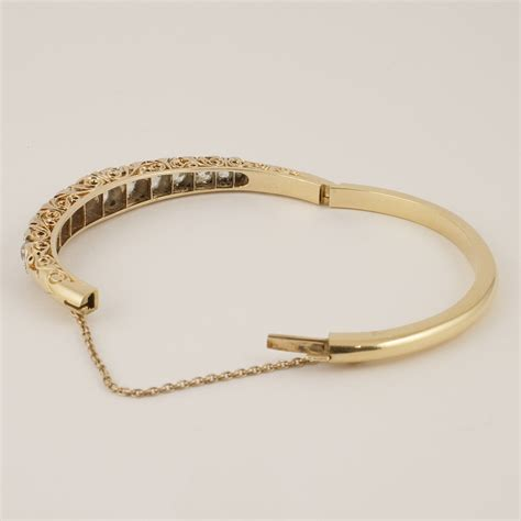 antique gold and hinged bangle bracelet