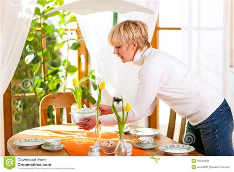 setting the table woman setting the table for tea of coffee time stock image