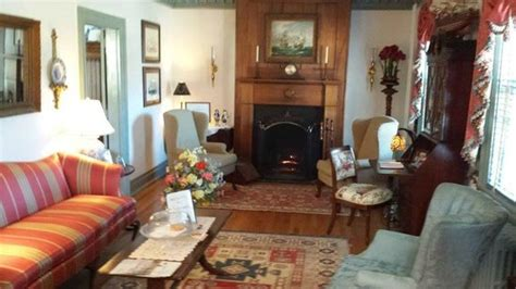 this is the sitting room living room with a cozy fireplace