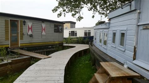 living on a boat on dry land floating on dry land 17 derelict houseboats find new home