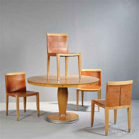 ching wing lo for giorgetti dining table and four aro