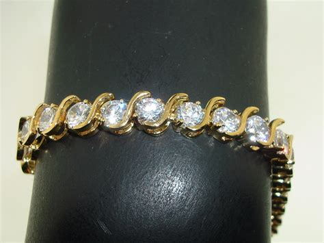 GOLD PLATED STERLING APPROX. 17 CTW BRILLIANT CZ TENNIS BRACELET SIGNED DBJ!   Federal Coin Exchange